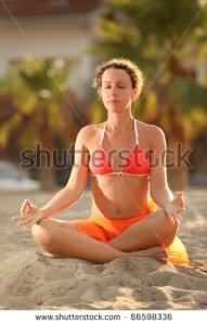 stock-photo-young-woman-in-orange-bikini-sitting-on-beach-in-lotus-pose-with-closed-eyes-and-meditating-palms-66598336