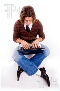 Top-View-Sitting-Man-Working-Computer-1100206